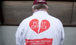 A Post Office worker during a strike last month over closures, jobs and pensions.