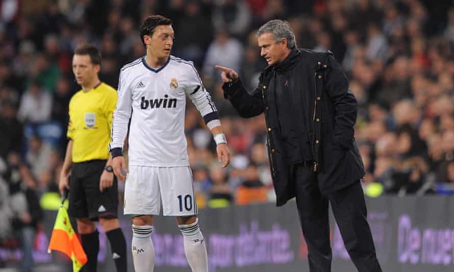 José Mourinho gives instructions to Mesut Özil during their time together at Real Madrid.
