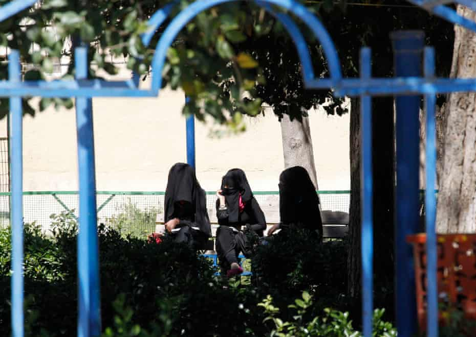 Dress codes and protection rackets … veiled women sit on a bench in Raqqa.