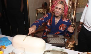 Lil Pump with a drug-shaped cake.