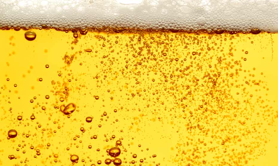 a close up of beer in a glass