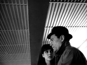 Anna Karina and Eddie Constantine in the film Alphaville Une Etrange Aventure De Lemmy Caution, 1965, directed by Jean-Luc Godard