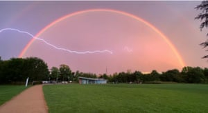 Dunstable, UKA lightning striking in front of a rainbow at Houghton Hall Park