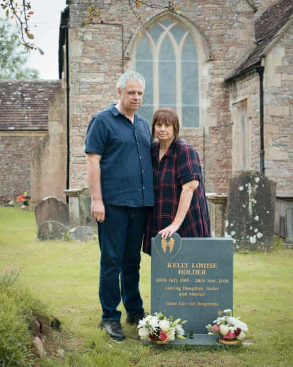 Paul and Glynis Holder in the Gloucestershire graveyard where their daughter is buried.