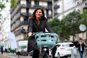 "Anne Hidalgo rides one of the new ""Velib Metropole"" bicycles during their launch in Paris last year"