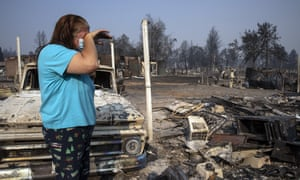 Heather Marshall stands by the destruction of her home at Coleman Creek Estates mobile home park in Phoenix.