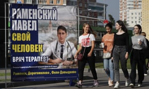 A campaign banner of a candidate in the Moscow city elections.