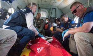 Jeremy Farrar, left, in action in DRC.