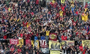 Livorno fans get their support on against their rather more right-leaning Lazio counterparts.