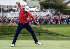 Gary Woodland reacts as he sinks a birdie putt on the final hole.