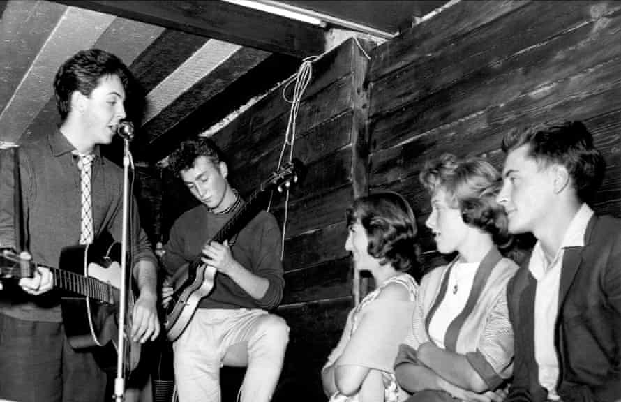 Paul McCartney on John Lennon, then still known as the Quarrymen perform at their first concert at the Casbah Coffee House on August 29, 1959 in Liverpool, England.