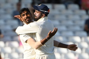 India's Jasprit Bumrah (L) celebrates with Lokesh Rahul after taking the wicket of Jos Buttler for 106.