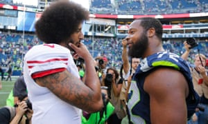 Colin Kaepernick (left) and Michael Bennett (72) talk on the field after a game last season. Both men have refused to stand for the anthem