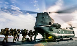 An RAF helicopter collects troops from the RN ship RFA Lyme Bay