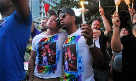 Bryan Manley and Greg Mitchell, who lost their best friend in the Pulse nightclub shooting, join a candlelight vigil at Lake Eola Park in Orlando.