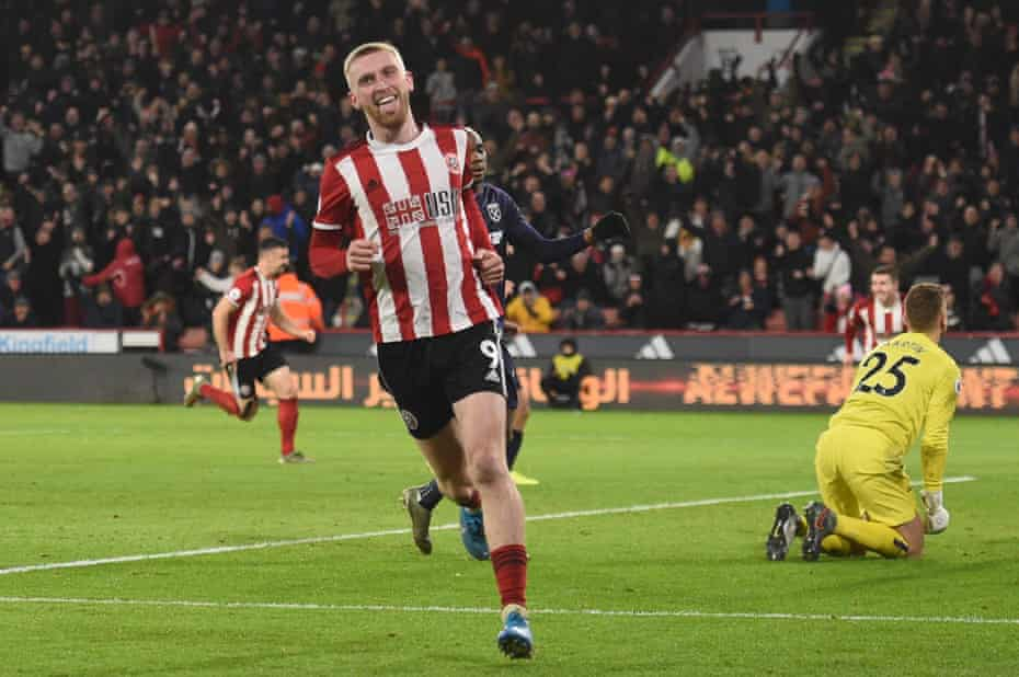 Oli McBurnie celebrates after the Blades capitalised on David Martin's error.