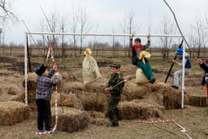 Children play at a goalpost during the traditional Cossack games outside the village of Arkhonskaya in the Republic of North Ossetia, Alania
