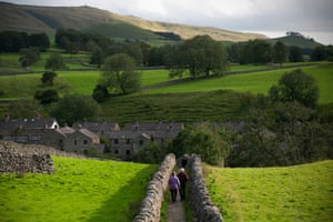 August 2020: a couple take a stroll in the Yorkshire Dales near the market town of Grassington