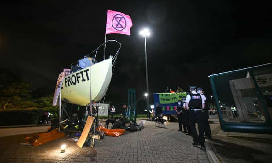 Extinction rebellion protestors blockade Newprinters publishing factory in Knowsley, Liverpool, last Friday.