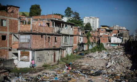 Trash fills an area in the Favela do Metro slum outside Maracana stadium where some lost their homes two years ago for the area to be renovated for the 2014 World Cup and 2016 Olympics. Some people have reoccupied the homes and are fighting to stay.