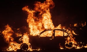 Flames from the Kincade fire consume a car in the Jimtown community of unincorporated Sonoma county.