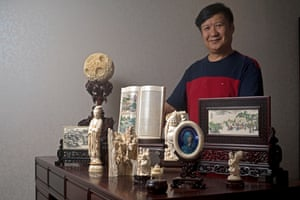 Guan Weiqiang with some of his ivory