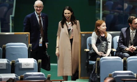 Jacinda Ardern reacts as she sees her baby Neve at the UN