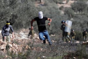 Kafr Qaddum, West Bank Palestinian demonstrators run in front of Israeli troops during a protest against Jewish settlements