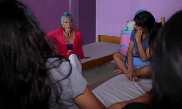 Silvia Barbarán chats to a group of girls at her orphanage for children with HIV in Iquitos.