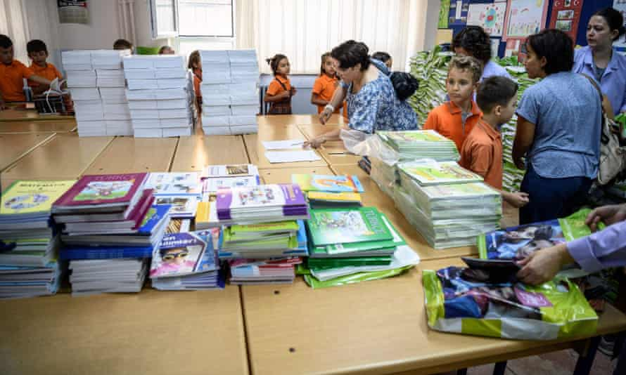 Children queue to receive books on the first day back at school in Turkey.