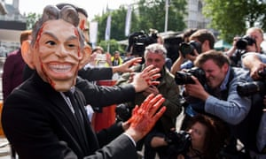 Protesters dressed as Tony Blair hold a demonstration outside the Queen Elizabeth II Conference Centre as they waited for the release of the Chilcot Inquiry
