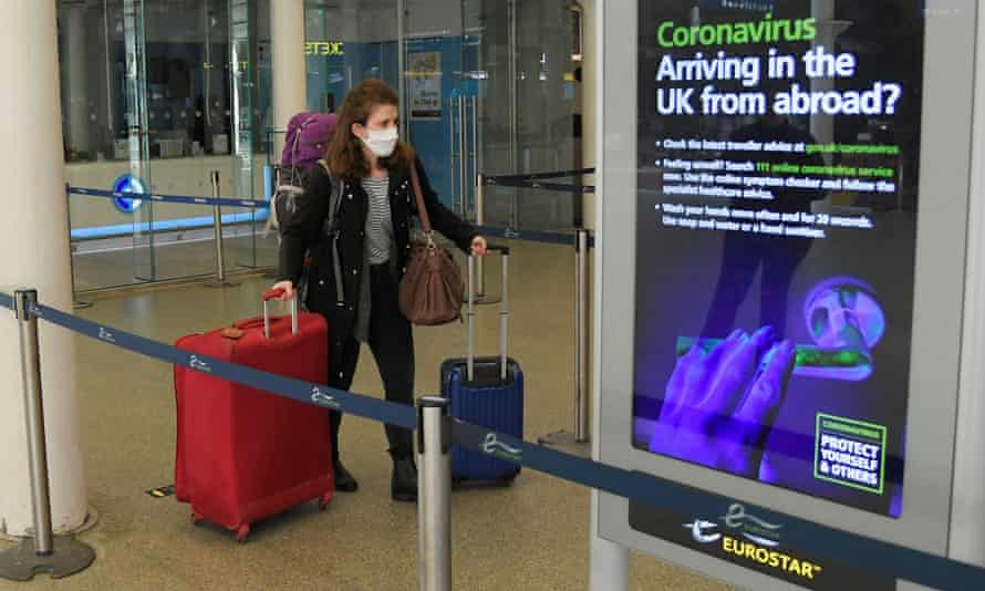 A woman with luggage at the Eurostar terminal in St Pancras station, London