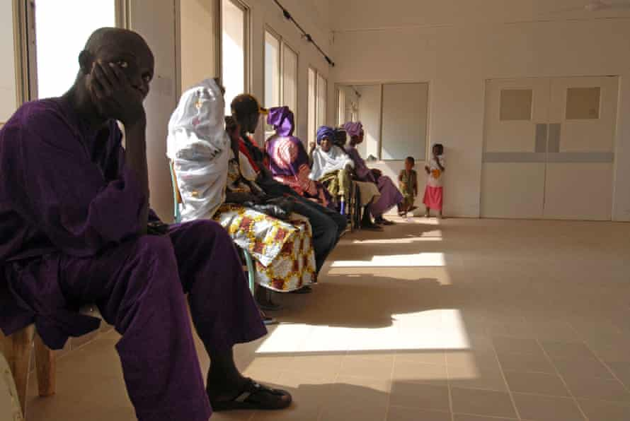 People suffering from HIV wait to be treated by Yahya Jammeh at Serrekunda hospital in Banjul, capital of the Gambia, in 2007