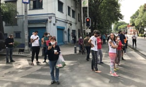 People stand on the street in Mexico City after the earthquake