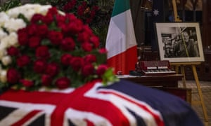 The Italian flag, a photograph and a piano accordion are seen alongside the flag-draped casket of Sisto Malaspina at the Pellegrini's co-owner's state funeral at St Patrick's Cathedral in Melbourne.