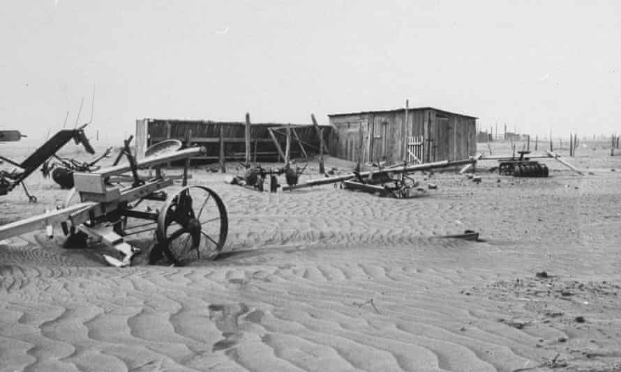 Abandoned farm buildings and machinery in the dust bowl caused by poor farming technique, as seen in May 1935.