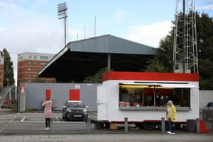 Women wait at a mobile sandwich bar outside The Racecourse Stadium on Thursday.