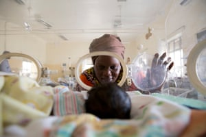 Await Said looks at her newborn grandson, Ayah, whose mother died after his delivery. He has jaundice and sepsis and weighs only 1.3kg. The hospital does not have the equipment to properly test and treat Ayah