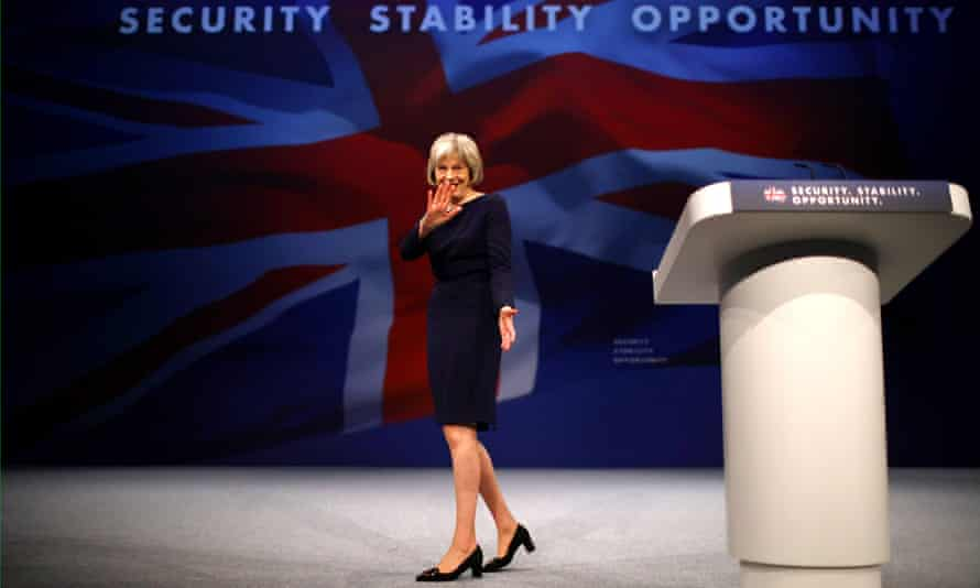 Theresa May leaves the stage after delivering her keynote speech at the Conservative party conference