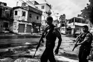Daily Life, third prize, stories - Sebastien Liste - Citizen journalism in Brazil's favelas: Police patrol the streets of Vila Aliança, a favela near Complexo do Alemao