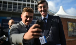 Jacob Rees-Mogg poses for a selfie with a supporter outside the Manchester Central Convention Centre on the third day of the conference.