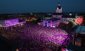 People who could not get a ticket gather in Springer Market square to listen to the Tragically Hip in downtown Kingston, Ontario