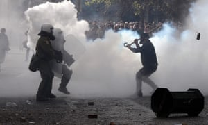 Farmers clash with police surrounded by tear gas