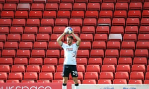 Luton's Rhys Norrington-Davies in front of an empty stand at Barnsley last Saturday. The EFL believes fans could safely return to stadiums.
