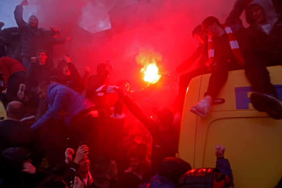 Liverpool fans with flares on top of police vans outside the Arkells pub before the Liverpool v Roma Champions League semi-final 1st leg at Anfield in April 2018