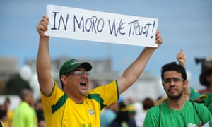 Opponents of the Brazilian government take part in a protest demanding President Dilma Rousseff's resignation on 13 March in Brasília. The placard refers to the chief investigating judge in the Petrobras scandal, Sérgio Moro.