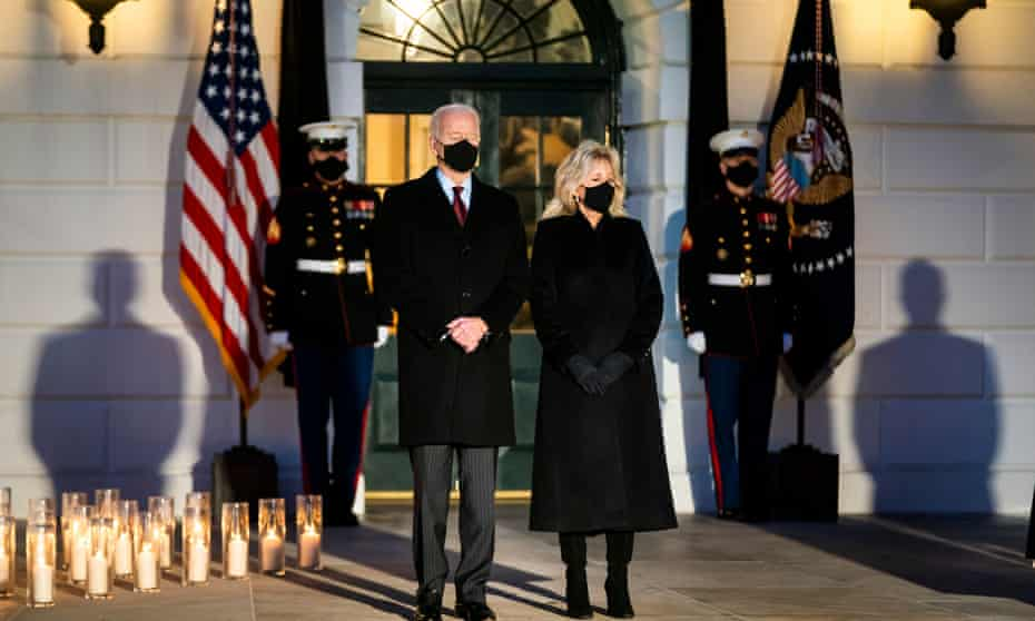 US president Joe Biden and his wife Jill observe a moment of silence for the 500,000 American victims of Covid-19 outside the White House
