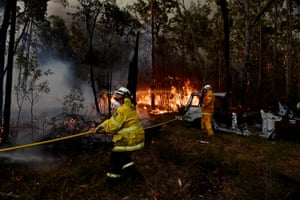 RFS firefighters working to save property near Sussex Inlet on New Year's Eve.