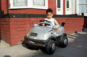 Boy with BMW toy car