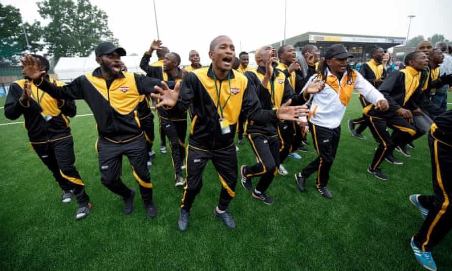 The Matabeleland squad dance and sing as they parade round the pitch before the Barawa v Tamil Eelam.